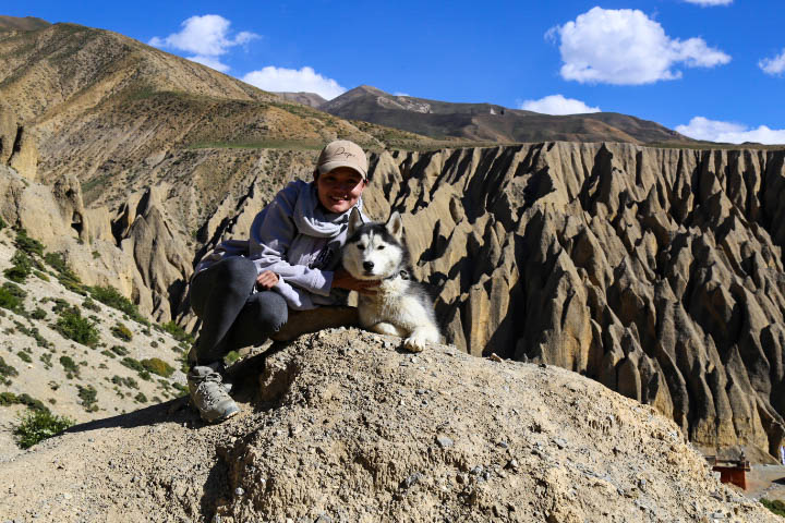dog and human at Luri Gompa